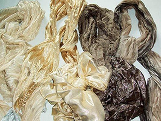 Articoli piatti/plissé con fibra metallizzata