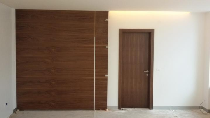 Walnut wall cover with doors