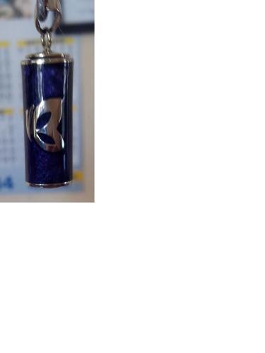 Tubito guardapelo fabricado en plata y resina