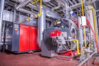 Self-fired waste heat boiler
